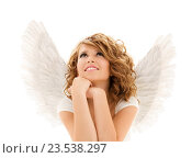 happy young woman or teen girl with angel wings. Стоковое фото, фотограф Syda Productions / Фотобанк Лори
