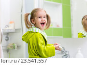 Купить «Cute little girl washing in bathroom», фото № 23541557, снято 30 сентября 2015 г. (c) Оксана Кузьмина / Фотобанк Лори