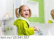 Купить «Cute little girl washing in bathroom», фото № 23541557, снято 30 сентября 2015 г. (c) Оксана Кузьмина / Фотобанк Лори