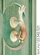 Купить «A decorative Bronze Door Handle, Mdina, Malta», фото № 23542521, снято 29 июля 2015 г. (c) Serg Zastavkin / Фотобанк Лори
