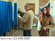 Купить «Мое первое голосование», фото № 23545649, снято 18 сентября 2016 г. (c) Владимир Макеев / Фотобанк Лори