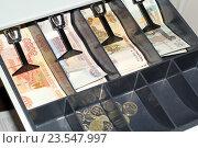 Купить «Деньги в кассе», эксклюзивное фото № 23547997, снято 18 сентября 2016 г. (c) Яна Королёва / Фотобанк Лори
