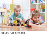 Купить «Little kids boys fun playing with wooden railway», фото № 23549353, снято 23 февраля 2016 г. (c) Оксана Кузьмина / Фотобанк Лори