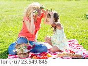 Купить «Mother and child having fun picnicking on grass», фото № 23549845, снято 3 сентября 2015 г. (c) Оксана Кузьмина / Фотобанк Лори