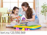 Купить «Child little girl and mother playing with kinetic sand at home», фото № 23550569, снято 4 марта 2016 г. (c) Оксана Кузьмина / Фотобанк Лори