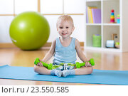 Купить «Child boy doing fitness exercises», фото № 23550585, снято 29 февраля 2016 г. (c) Оксана Кузьмина / Фотобанк Лори