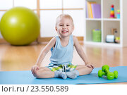Купить «Child boy ready to fitness exercises», фото № 23550589, снято 29 февраля 2016 г. (c) Оксана Кузьмина / Фотобанк Лори