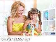 Купить «child and mom playing wooden toys at home», фото № 23557809, снято 6 августа 2015 г. (c) Оксана Кузьмина / Фотобанк Лори