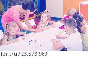 Купить «children sitting together and drawing in class at school», фото № 23573969, снято 22 ноября 2019 г. (c) Яков Филимонов / Фотобанк Лори