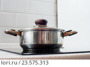 Pots and Pans cooking on stove. Стоковое фото, фотограф Алексей Суворов / Фотобанк Лори