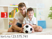Купить «child boy with dad play foot ball at home», фото № 23575741, снято 4 октября 2014 г. (c) Оксана Кузьмина / Фотобанк Лори