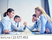 Купить «smiling business people having conflict in office», фото № 23577453, снято 25 октября 2014 г. (c) Syda Productions / Фотобанк Лори