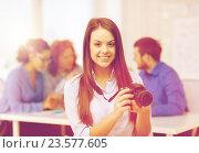 Купить «smiling female photographer with photocamera», фото № 23577605, снято 1 февраля 2014 г. (c) Syda Productions / Фотобанк Лори
