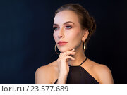 Купить «beautiful woman in black wearing diamond jewelry», фото № 23577689, снято 14 апреля 2016 г. (c) Syda Productions / Фотобанк Лори