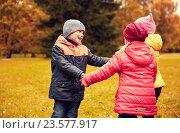 Купить «children holding hands and playing in autumn park», фото № 23577917, снято 10 октября 2015 г. (c) Syda Productions / Фотобанк Лори