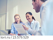 Купить «group of smiling businesspeople meeting in office», фото № 23579529, снято 25 октября 2014 г. (c) Syda Productions / Фотобанк Лори