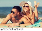 Купить «happy couple in swimwear lying on summer beach», фото № 23579553, снято 11 августа 2015 г. (c) Syda Productions / Фотобанк Лори