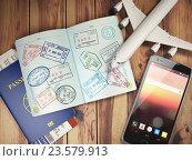 Купить «Travel and tourism concept. Passport with visas and boarding passes, airplane and mobile on the wood table.», фото № 23579913, снято 20 апреля 2018 г. (c) Maksym Yemelyanov / Фотобанк Лори
