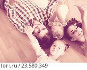 Купить «Family values: portrait of parents with little girls indoors», фото № 23580349, снято 24 сентября 2018 г. (c) Яков Филимонов / Фотобанк Лори