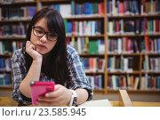Купить «Thoughtful female student using a mobile phone», фото № 23585945, снято 16 июня 2016 г. (c) Wavebreak Media / Фотобанк Лори