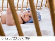 Купить «Cute baby boy relaxing on a cradle», фото № 23587789, снято 22 января 2016 г. (c) Wavebreak Media / Фотобанк Лори