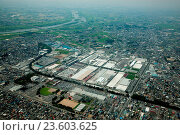 Купить «Asia, Japan, Kanto Region, Gunma Prefecture, Ora District, Aerial view of Sanyo Electric Tokyo mill with cityscape. (Photo by: JTB Photo/UIG via Getty Images)», фото № 23603625, снято 16 ноября 2018 г. (c) age Fotostock / Фотобанк Лори