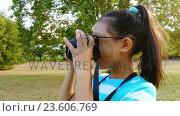 Купить «Girl clicking a photograph from camera», видеоролик № 23606769, снято 21 ноября 2018 г. (c) Wavebreak Media / Фотобанк Лори