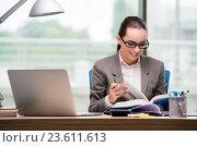 Купить «Businesswoman working at her desk», фото № 23611613, снято 15 августа 2016 г. (c) Elnur / Фотобанк Лори
