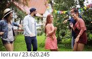 Купить «happy friends dancing at summer party in garden», видеоролик № 23620245, снято 4 сентября 2016 г. (c) Syda Productions / Фотобанк Лори