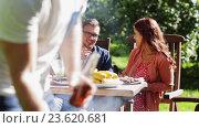 Купить «happy friends at barbecue party in summer garden», видеоролик № 23620681, снято 7 сентября 2016 г. (c) Syda Productions / Фотобанк Лори