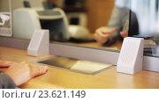 Купить «clerk counting money and customer at bank office», видеоролик № 23621149, снято 19 сентября 2016 г. (c) Syda Productions / Фотобанк Лори