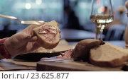 Купить «Woman eating bread with meat paste in the cafe», видеоролик № 23625877, снято 22 сентября 2016 г. (c) Данил Руденко / Фотобанк Лори