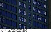Купить «Time of arrived planes in flight schedule», видеоролик № 23627297, снято 4 июня 2016 г. (c) Данил Руденко / Фотобанк Лори