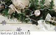 Купить «Wreath with christmas decoration on a plank», видеоролик № 23639173, снято 4 августа 2020 г. (c) Wavebreak Media / Фотобанк Лори