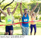 Купить «happy young male runner winning on race finish», фото № 23655017, снято 16 августа 2015 г. (c) Syda Productions / Фотобанк Лори