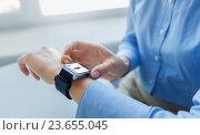 Купить «close up of hands with fitness app on smart watch», фото № 23655045, снято 13 августа 2015 г. (c) Syda Productions / Фотобанк Лори
