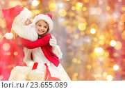 smiling little girl with santa claus. Стоковое фото, фотограф Syda Productions / Фотобанк Лори