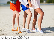 Купить «close up of women legs posing on beach», фото № 23655165, снято 7 июня 2016 г. (c) Syda Productions / Фотобанк Лори