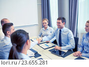 group of smiling business people meeting in office. Стоковое фото, фотограф Syda Productions / Фотобанк Лори