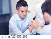 Купить «businessmen arm wrestling in office», фото № 23655285, снято 25 октября 2014 г. (c) Syda Productions / Фотобанк Лори