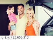 Купить «happy family with hatchback car at home parking», фото № 23655313, снято 11 августа 2015 г. (c) Syda Productions / Фотобанк Лори
