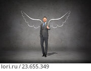 Купить «businessman with angel wings showing thumbs up», фото № 23655349, снято 17 ноября 2018 г. (c) Syda Productions / Фотобанк Лори