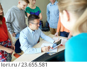Купить «students and teacher with tablet pc at school», фото № 23655581, снято 22 апреля 2016 г. (c) Syda Productions / Фотобанк Лори