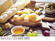 Купить «Сырная тарелка», фото № 23669985, снято 8 марта 2016 г. (c) Вероника Галкина / Фотобанк Лори