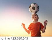 Купить «Girl plays football.», фото № 23680545, снято 2 июня 2016 г. (c) Константин Юганов / Фотобанк Лори