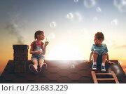 Купить «child blowing soap bubbles», фото № 23683229, снято 21 марта 2016 г. (c) Константин Юганов / Фотобанк Лори