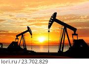 Купить «silhouette of working oil pumps on sunset background», фото № 23702829, снято 15 марта 2015 г. (c) easy Fotostock / Фотобанк Лори