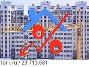 Купить «Красный знак процента на фоне строительства дома», фото № 23713681, снято 3 мая 2016 г. (c) Сергеев Валерий / Фотобанк Лори