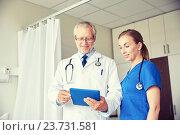 Купить «senior doctor and nurse with tablet pc at hospital», фото № 23731581, снято 11 июня 2015 г. (c) Syda Productions / Фотобанк Лори