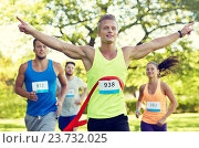 Купить «happy young male runner winning on race finish», фото № 23732025, снято 16 августа 2015 г. (c) Syda Productions / Фотобанк Лори